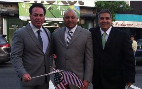 A Facebook photo from June where Hector Hernandez (far right) poses with Commissioner Count Wiley (far left) and Pastor Rafael Sanchez, Jr.