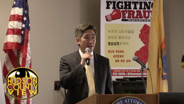 """Steve Lee, the Acting Director of the NJ Division of Consumer Affairs, speaks at a """"Fighting Fraud"""" seminar in Jersey City in May."""