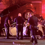 Police: Bayonne driver speeds through red light, buries car underneath parked SUV