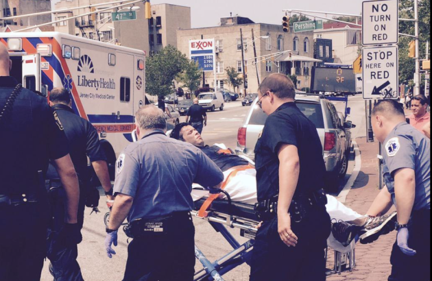 Photo of man being stretchered to ambulance following crash in Weehawken via Twitter user atlatlone.