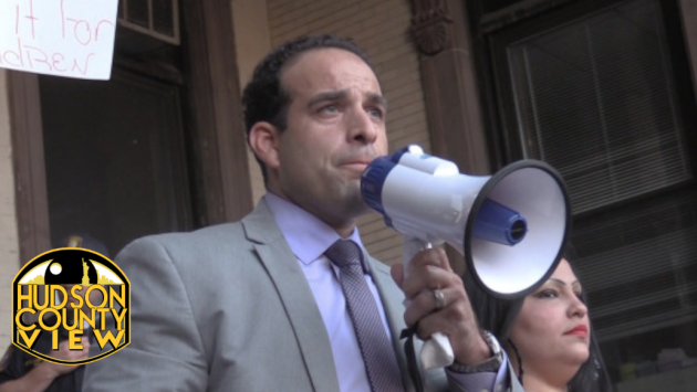 Carmelo Garcia hosting a rally before a Hoboken Housing Authority meeting where he was terminated from his post as executive director on August 4, 2014.