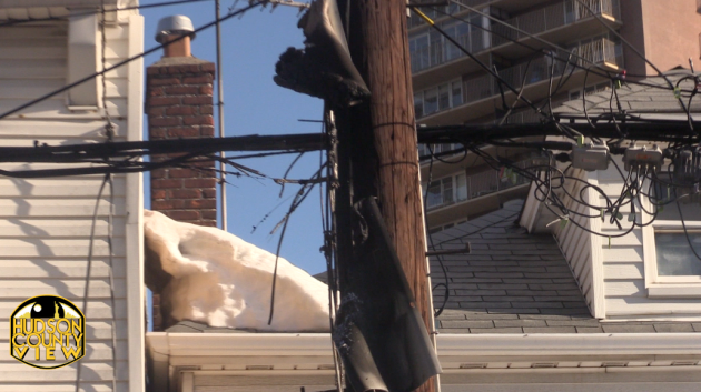 A charred utility pole near the intersection of 61st Street and Park Avenue moments after an electrical fire was extinguished.