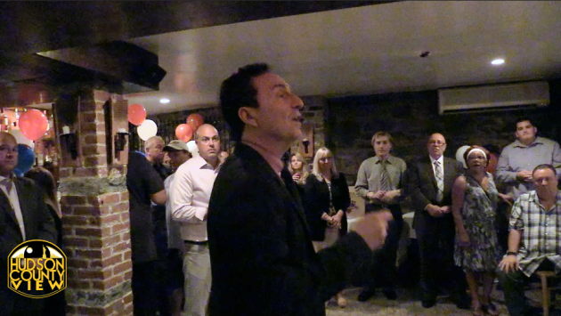 Hoboken Freeholder Anthony Romano (D-5) speaks at Ward 2 Council candidate Peter Biancamano's fundraiser at Lola's Tapas Bar on September 17, 2015. Pablo Fonseca, far left, also pictured in the background.
