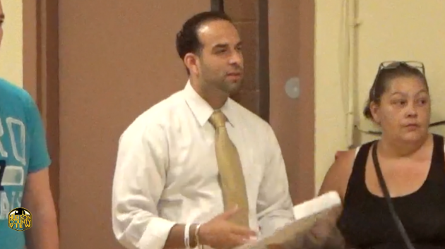 Carmelo Garcia stands in the audience during an August 26, 2014 meeting of the Hoboken Housing Authority, the first public meeting after he was fired as executive director.