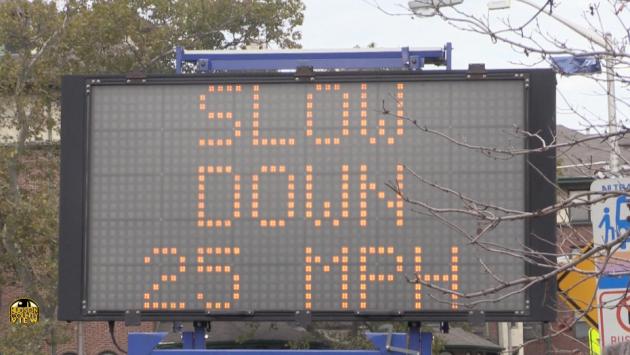 JFK speed sign