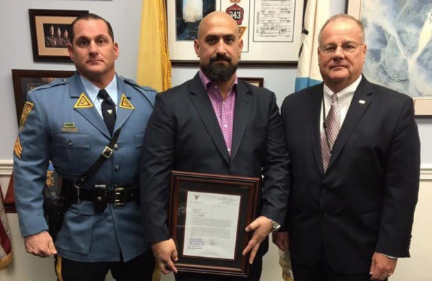 Michael Citarella (middle), the managing partner of Hoboken's Texas Arizona, was honored by the New Jersey State Police yesterday. Photo via NJSP Facebook.