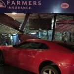 Unhappy New Year: Car slams into Farmers Insurance building in West New York