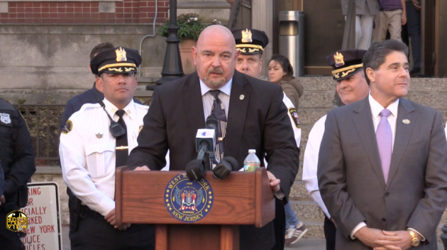 West New York Police Director Robert Antolos (middle) joined by other officers and Mayor Felix Roque at a press conference on November 4, 2016.