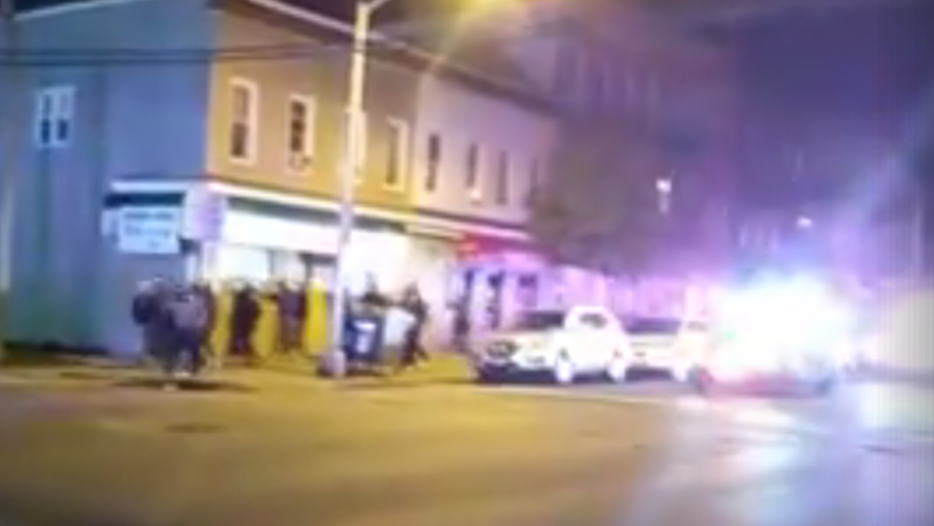 A screenshot of a Facebook video showing Bayonne police escorting a crowd back to the Jersey City border.