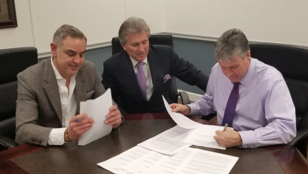 Mayor Jimmy Davis signing off on the Costco sale with Corporation Counsel Jay Coffey and JMF Development Founder and Principal  Joe Forgione. Photo courtesy of the City of Bayonne.