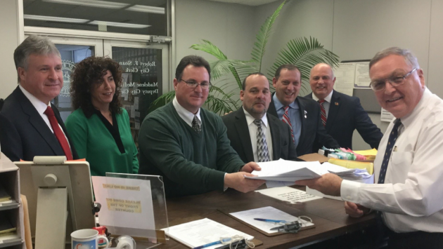 From left to right: Bayonne Mayor Jimmy Davis, Council members Sharon Nadrowski, Gary La Pelusa, Tom Cotter, Sal Gullace and Juan Perez, as well as City Clerk Bob Sloan. Photo courtesy of the Davis campaign.