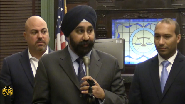 Then Hoboken Mayor-elect Ravi Bhalla (center) speaking  at a city council meeting in December. 3rd Ward Councilman Mike Russo (left) and Council President Ruben Ramos also pictured.