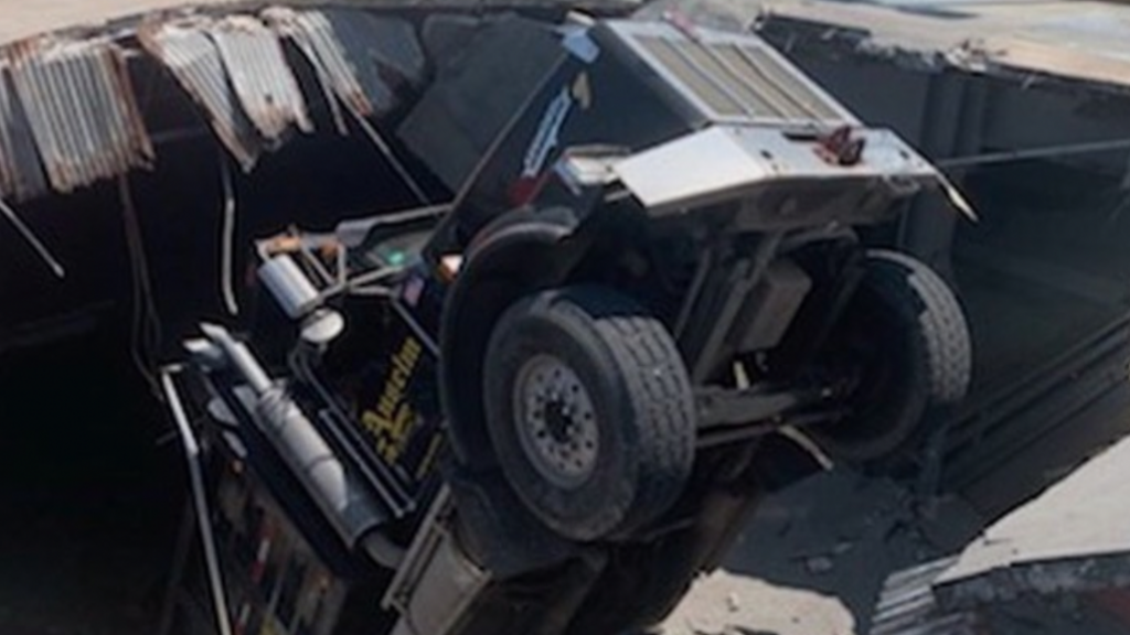 No injuries reported after truck falls through parking deck