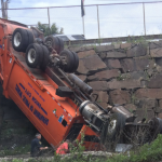 Union City DPW truck crashes through fence, overturns on Route 495 – 2 critically injured
