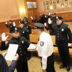 Despite no friends or family on hand, Jersey City still swore in 14 new police officers